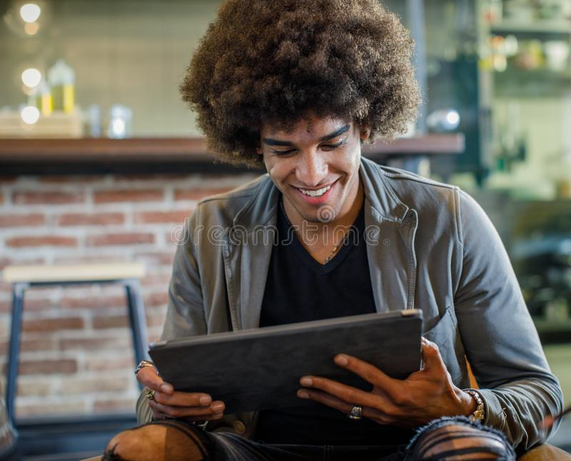 Afro american man smiling while using tablet near group of colleagues.Group of multiethnic people having business team royalty free stock photo