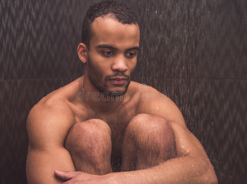 Afro American man taking shower royalty free stock photos