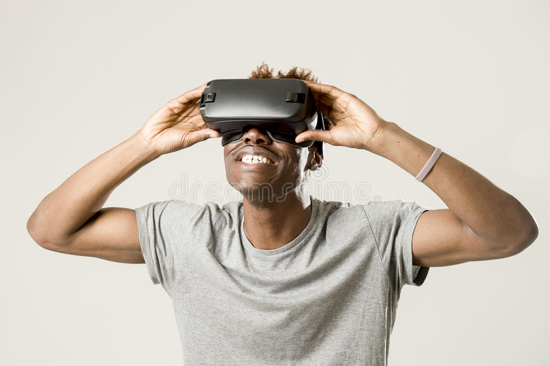 Afro american man wearing virtual reality vr 360 vision goggles enjoying video game royalty free stock photo