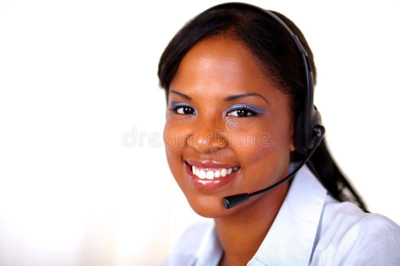 Afro-american receptionist looking at you stock photography