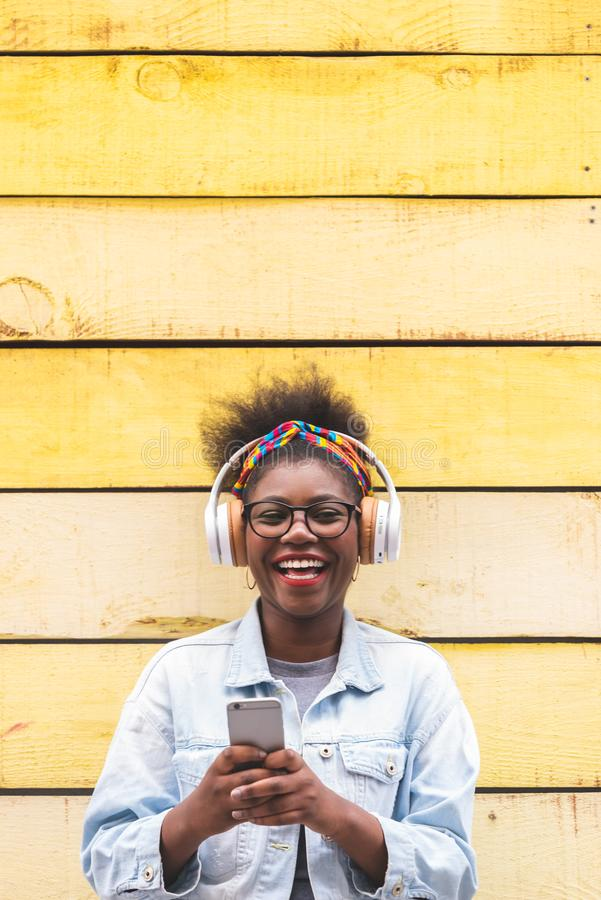 Afro American Teenage Girl Using Mobile Phone Outdoors stock photography