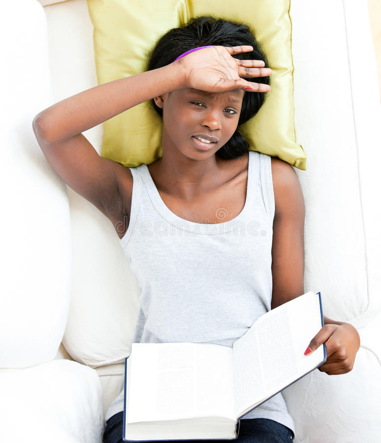 Download Afro-american Teenager Feeling Sick Holding A Book Stock Photo - Image: 15335590