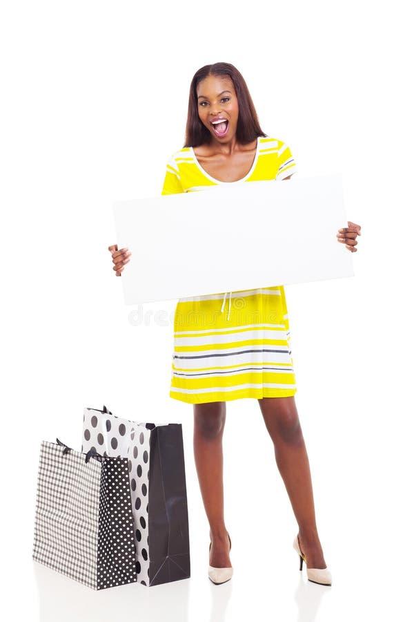Afro american woman blank billboard stock photo