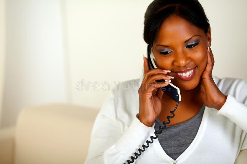 Afro-american woman conversing on phone stock photography