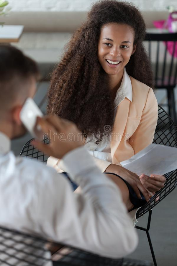 Afro-American worker during lunch stock image