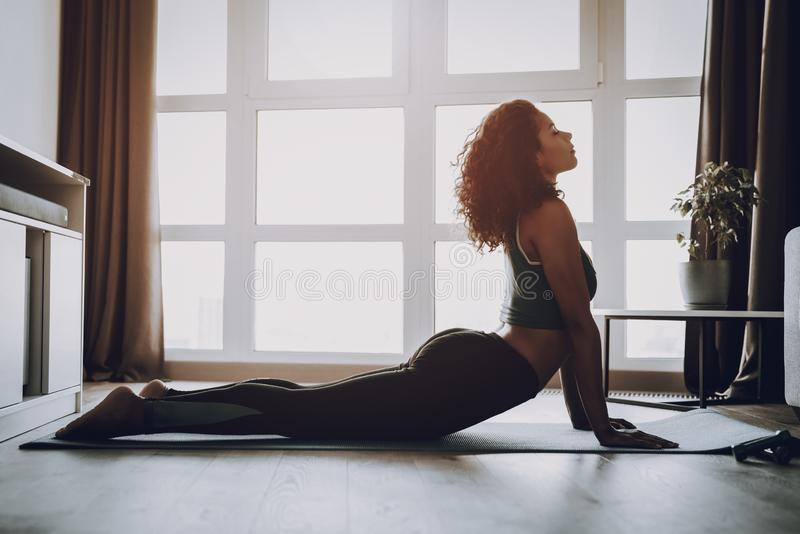 Afro American Young Girl. Home Fitness Concept. stock image