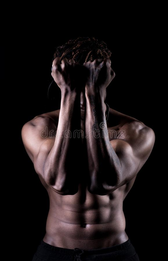 Afro American young man covering his face stock image