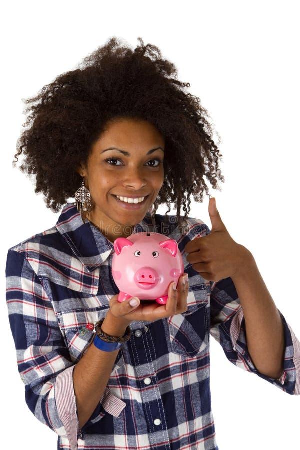 Afro-americano fêmea com banco piggy imagens de stock royalty free