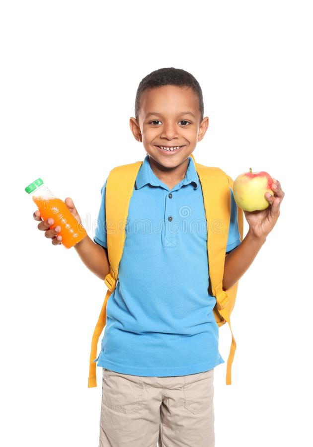 Afro-amerikanischer Schüler mit gesundem Lebensmittel stockfotos