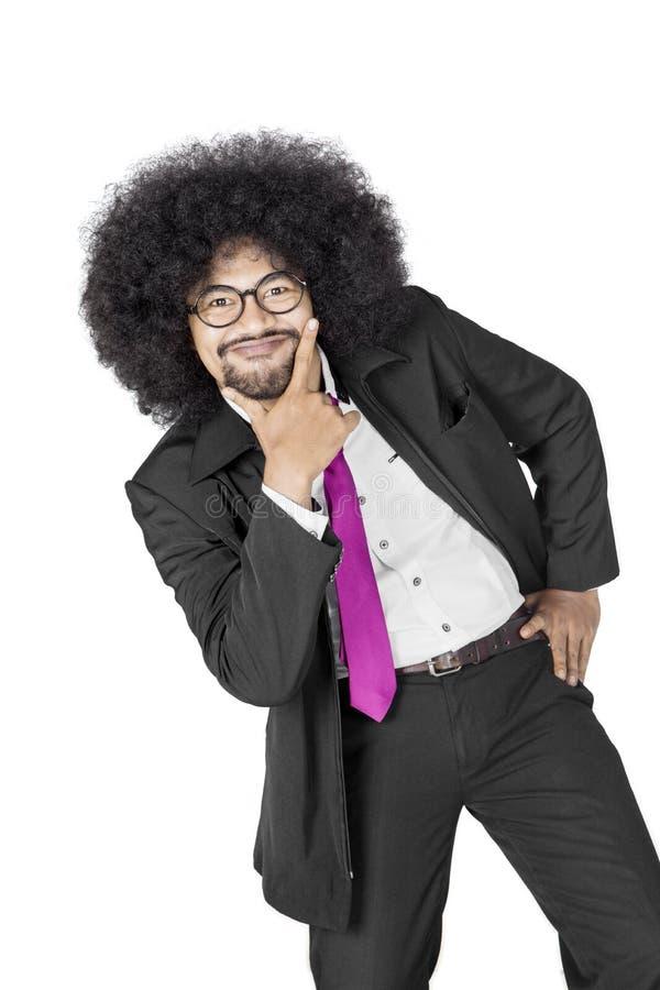 Afro biznesmen robi śmiesznej pozie na studiu zdjęcie royalty free