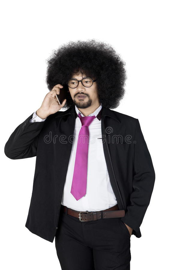 Afro businessman talking with mobile phone stock image