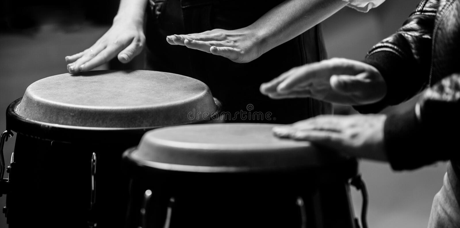 Afro Cuba, rum, drummer, fingers, hand, hit. Drum. Hands of a musician playing on bongs. The musician plays the bongo. Close up of musician hand playing bongos royalty free stock images