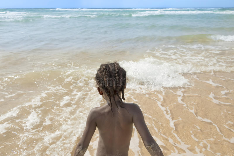 Afro girl at the beach, six years old royalty free stock photos