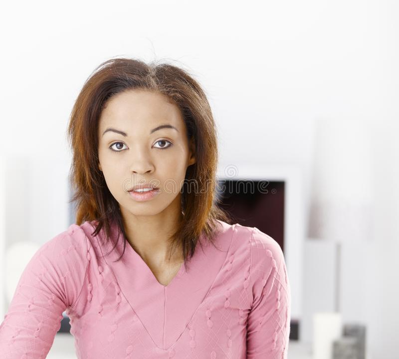 Afro girl at home. Portrait of afro girl at home, looking at camera stock photos