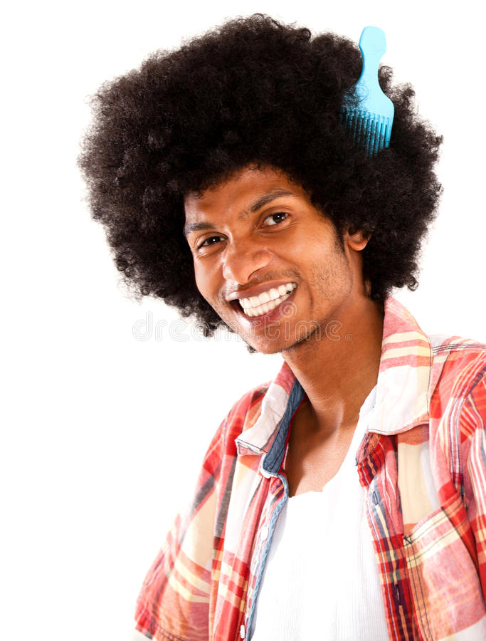 Afro man styling his hair