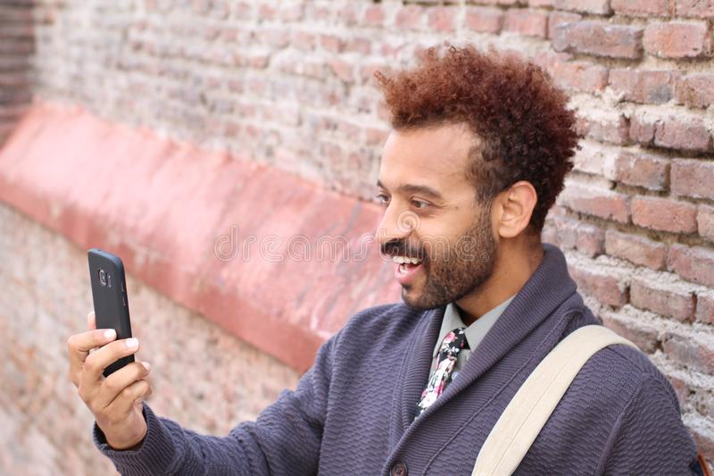 Afro man using cell phone.  royalty free stock photos