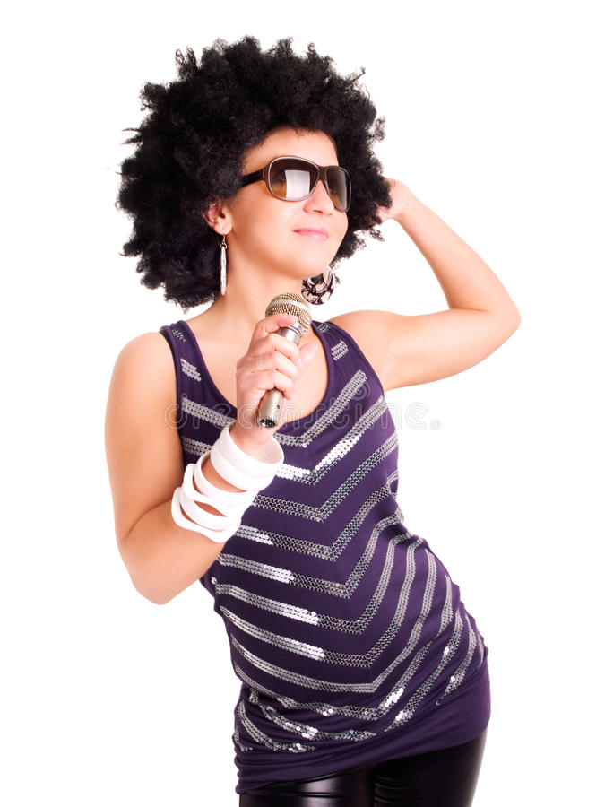 Afro singer holding microphone over white