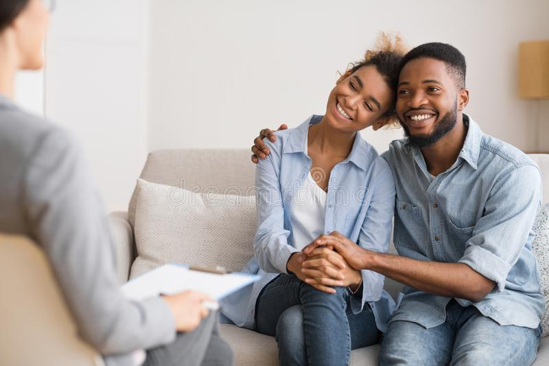 Afro Spouses Hugging Happily After Reconciling On Marital Counseling stock photography