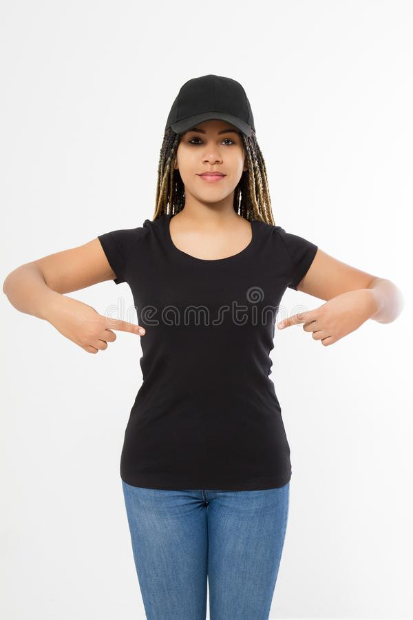 Afro woman in black template t shirt and baseball cap isolated on white background. Blank Sport hat and tshirt. African american royalty free stock images