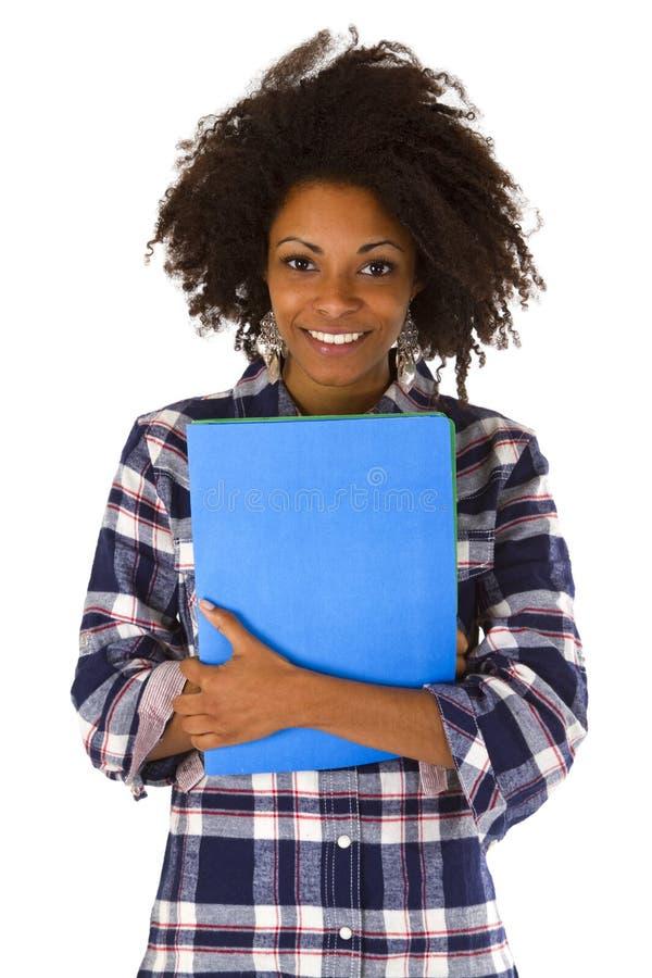 Afroamericano femminile con un'applicazione di lavoro fotografia stock