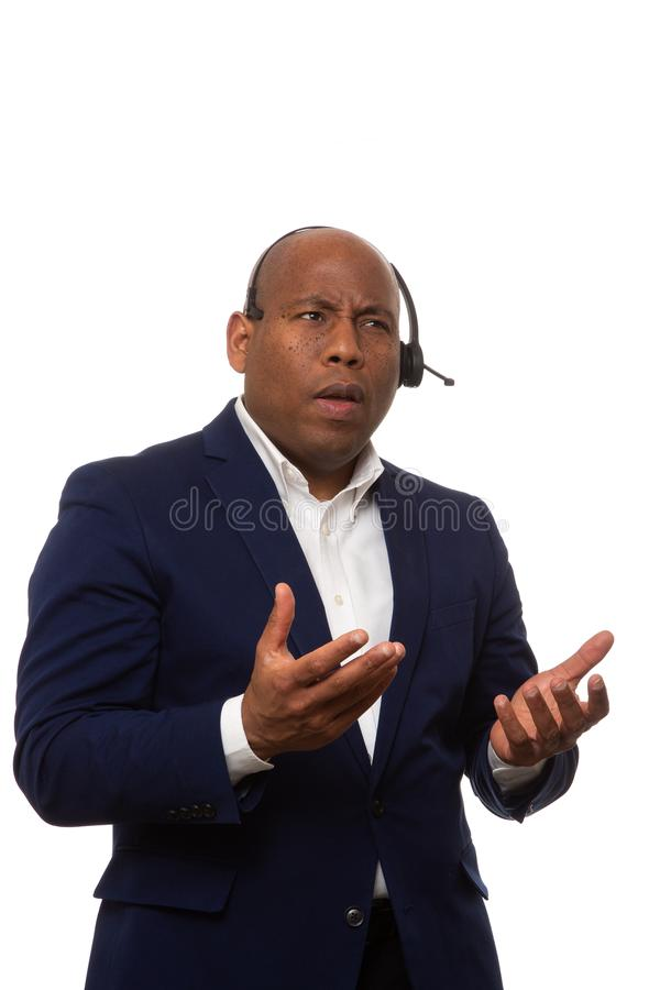 Afroamerikaner-Geschäftsmann Confused By Call stockbild