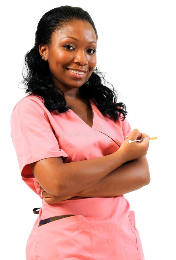 Afroamerikaner-Gesundheitspflegearbeitskraft mit Nadel stockbild