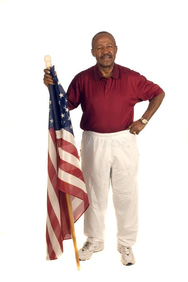 Afroamerikaner-Patriot mit Markierungsfahne lizenzfreie stockfotografie