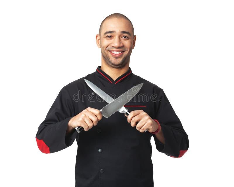 Afroer-amerikanisch Berufskoch, der die Messer - lokalisiert hält lizenzfreies stockfoto
