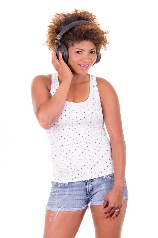 Afrovrouw het luisteren muziek. royalty-vrije stock foto