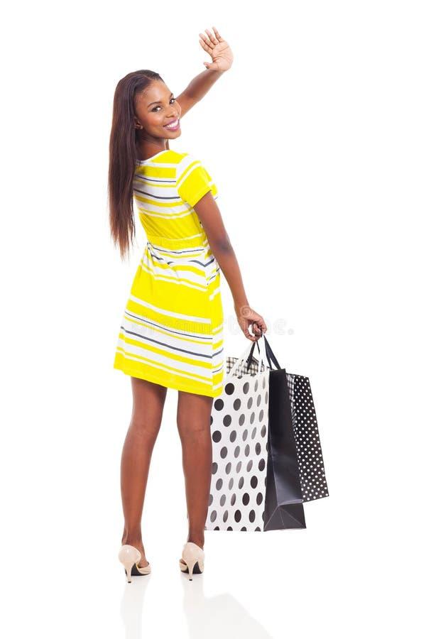 Afrykański kupującego falowanie obrazy stock