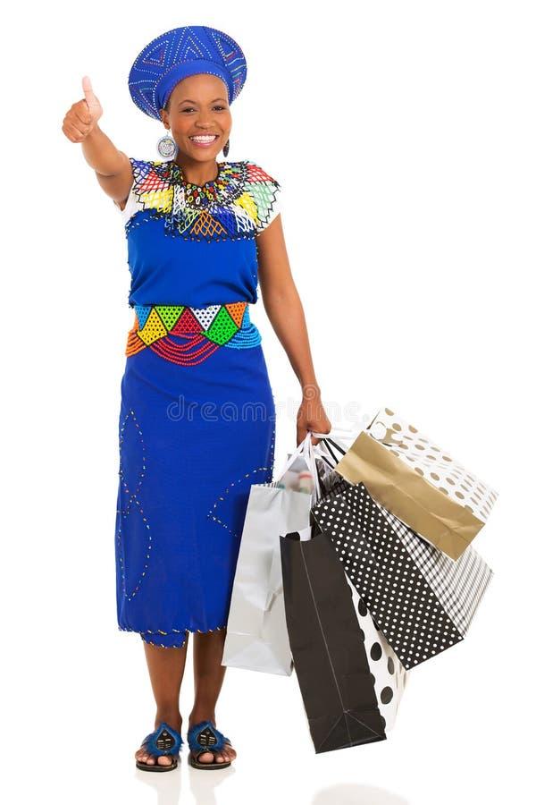 Afrykański kupującego kciuk up obraz royalty free