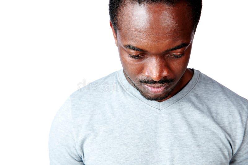 Afrykański mężczyzna patrzeje w dół fotografia royalty free