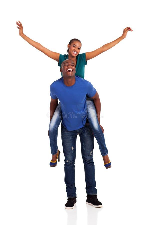 Afrykański pary piggyback fotografia royalty free