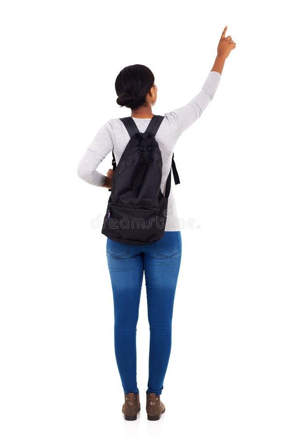 Afrykański szkoły wyższa dziewczyny wskazywać zdjęcie stock