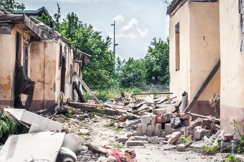 Aftermath catastrophe after hurricane or war disaster damaged and ruined house collapsed property with moody and dark sky.  royalty free stock photography