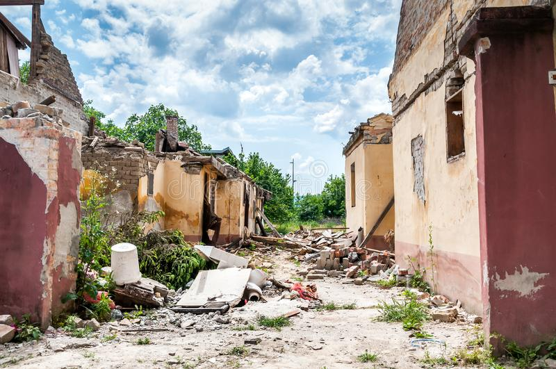 Aftermath catastrophe after hurricane or war disaster damaged and ruined house property with moody and dark sky.  royalty free stock images