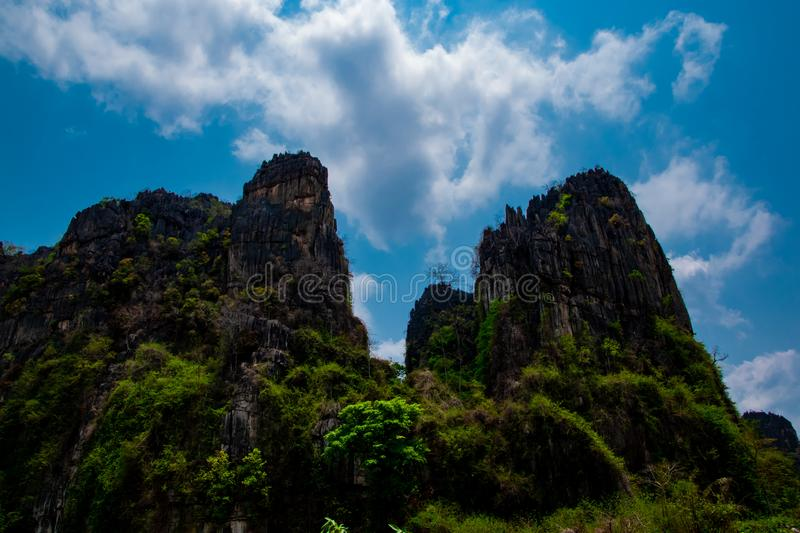 Stone hills and beautiful blue sky background in countryside landscape of Thailand,  Banmung,  Noenmaprang, Pitsanulok province . royalty free stock images