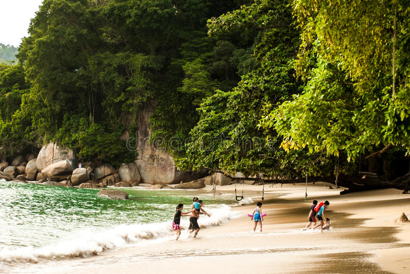Afternoon on beach, Pulau Pangkor, Malaysia - July 2015. Afternoon on beach, Pulau Pangkor, Malaysia, children playing - July 2015 royalty free stock photo
