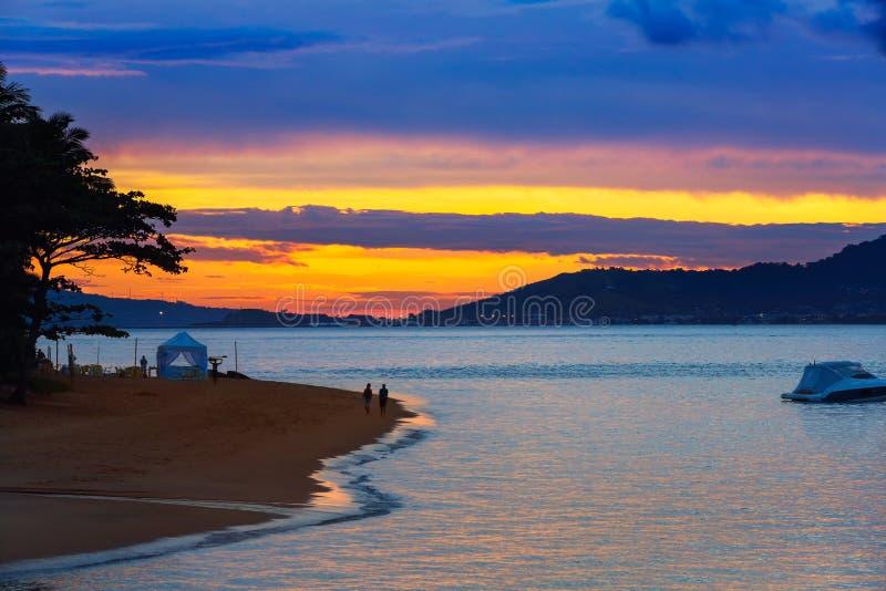 Beautiful reddish sky during the sunset. Coast stock photography