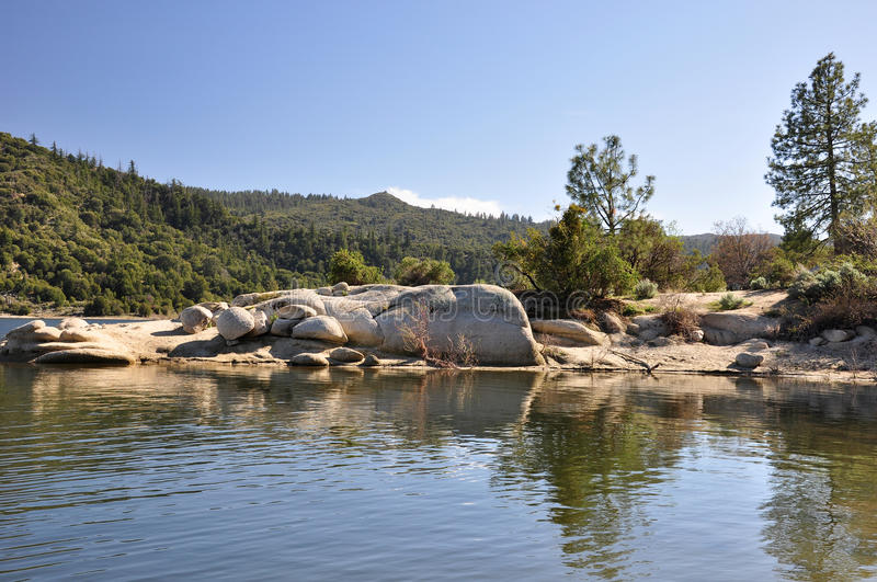 Afternoon on Lake Hemet. A rock outcropping juts out into Lake Hemet on Mount San Jacinto in Southern California stock photography