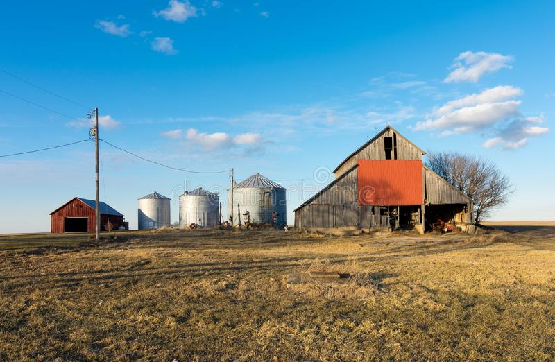 Afternoon in the Midwest. Rural farm with brilliant blue skies and clouds in background. Putnam County, Illinois, USA stock image