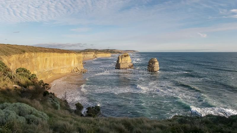 Afternoon shot of the twelve apostles looking east on the great ocean road. Afternoon shot of the twelve apostles looking east at port campbell on the great stock images