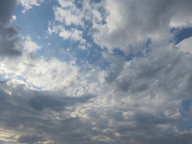 Afternoon sky above the city nice weather. Cloud accumulation in the sky royalty free stock photography