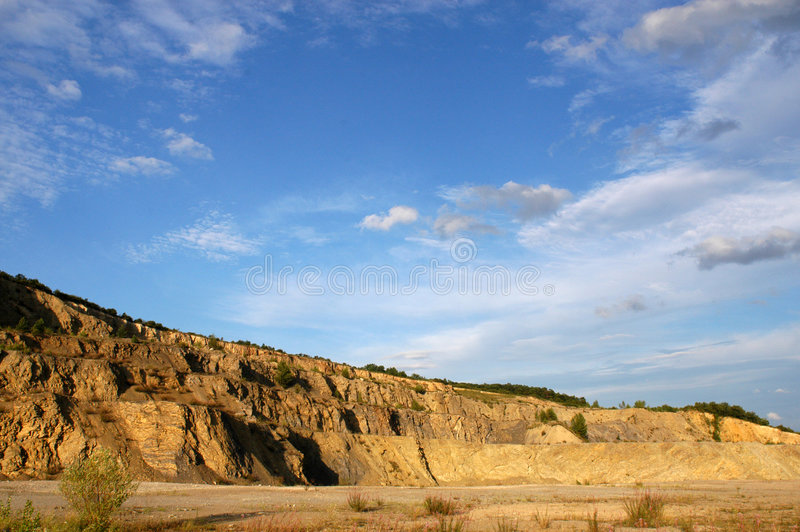 Afternoon in stone-pit. Sunny afternoon in empty stone-pit stock photo