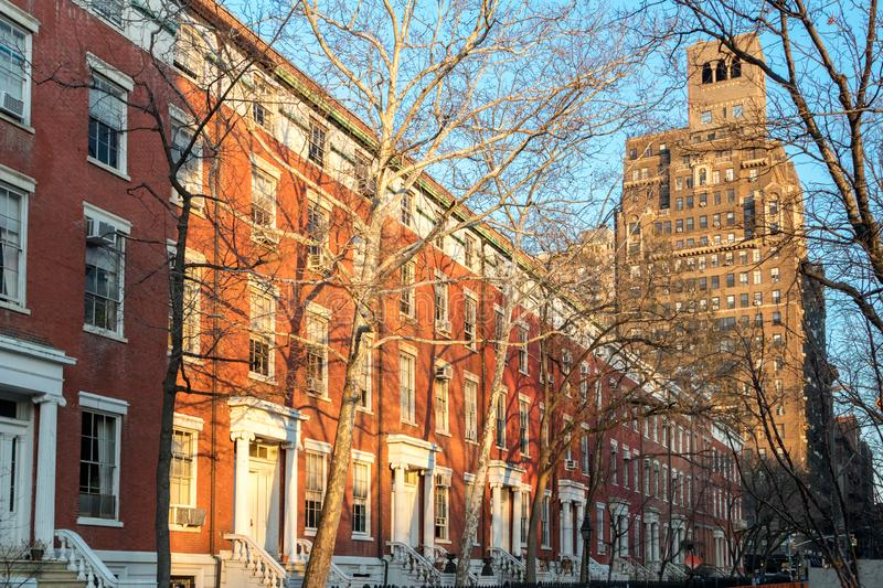 Afternoon sunlight shines on the historic buildings in New York City stock photos