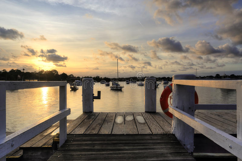 Afternoon sunset over Iron Cove Australia. The afternoon golden sun sets over Iron Cove , views from the timber wharf at Liechhardt Park, NSW, Australia royalty free stock images