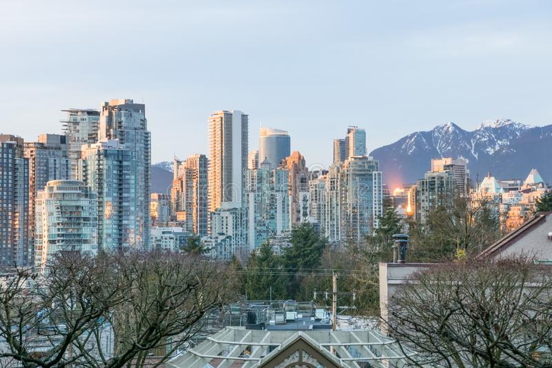 Afternoon sunset view over skyline Vancouver downtown with the mountains of north Vancouver in the background. Canada royalty free stock photo