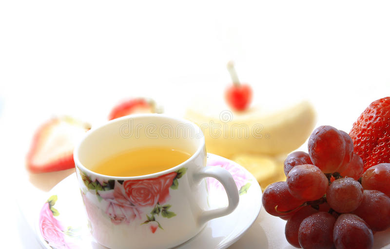 Afternoon tea. Can relax at the same time also give the body a complementary energy and slow time. A cup of tea and fruit royalty free stock image