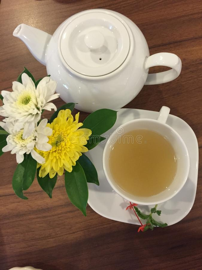 Afternoon Tea with flowers and good friend. Hot Tea with Flowers and good friend sunday afternoon royalty free stock photo