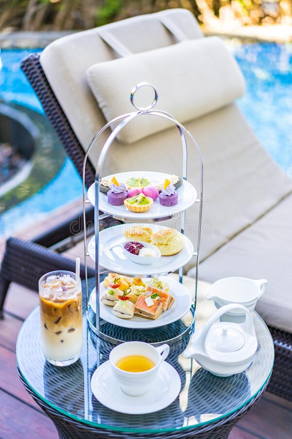 Afternoon Tea Set With Latte Coffee And Hot Tea On Table ...